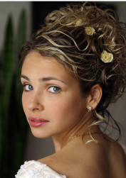 Small curls wedding hairstyle with small rose hairclips with swept wavy bangs.PNG