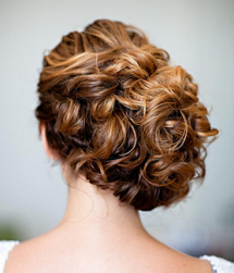 Trendy bridal with full of curls and updo is slightly on the right.PNG