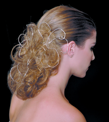 Unique bridal hairstyle with light curls and .PNG