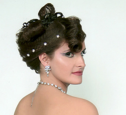 Unique curly bridal updo hairstyle with big roll bang.PNG