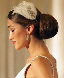 50s bridal hairstyle with feather hairclips for wedding.PNG