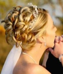 bride updo with rolls and tiara and veil.jpg