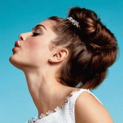 big roll wedding hairstyle with wedding jewelry.jpg