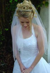 big roll wedding hairstyle with veil and tiara.jpg