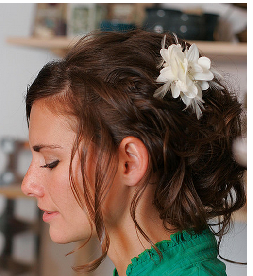 Wavy bridal hairstyle with white hairclip and swept bang.PNG