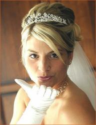 wedding updo with side bang with wedding accessories.jpg