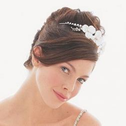 wedding updo with flower Tiara and long side bang.jpg