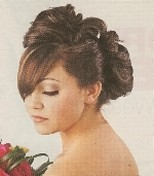 Wedding updo with big rolls.jpg
