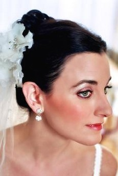 wedding hairstyle with white flower clip.jpg