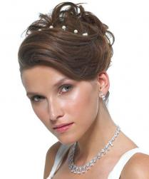 wedding hairstyle with wavy side bang with pearl tiara.jpg