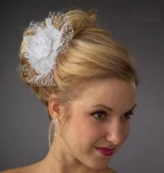 elegant wedding_hairstyle with white floral hair clip.jpg