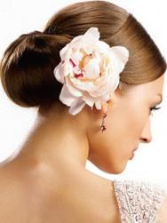 Classic wedding hairstyle with big pink flower.jpg